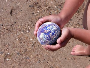 We hold the world in our hands - treat it gently.